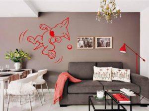 Vinilo decorativo Bull terrier jugando a la pelota.
